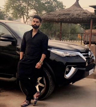 Kurta pajama designs for men - parmish verma in black kurta pajama with car 1