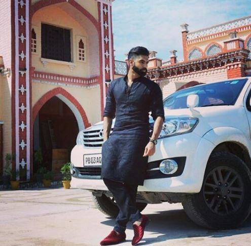 Kurta pajama designs for men - parmish verma in black kurta pajama with car