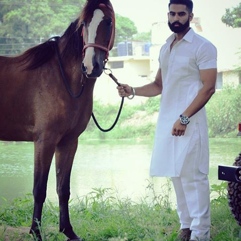 Kurta pajama designs for men - parmish verma in white kurta with horse next movie